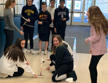 Design and launch of marshmallow catapult teaching force/motion