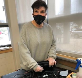 Ms. Crisci Preparing Computers to Send Home