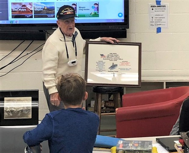 World War II Veteran, Petty Officer Edward Aurand, visits with 5th graders at Chardon Middle School.