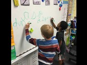 2nd graders practicing their cursive handwriting.