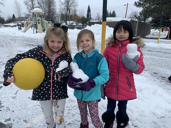 CES students building snow babies!