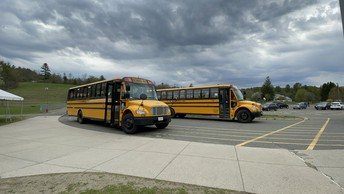 Buses waiting to transport students