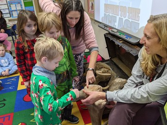 Ms. Beekman's students explore woolly mammoth bones through touch via a visit to Mrs. Whiting's 1st grade class at Park Elementary.