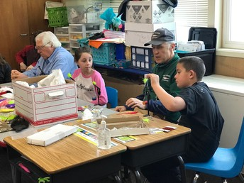 Feather River Trout Unlimited friends teaching 4th graders how to tie flies!