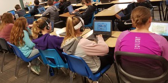 6th graders working on chrome books