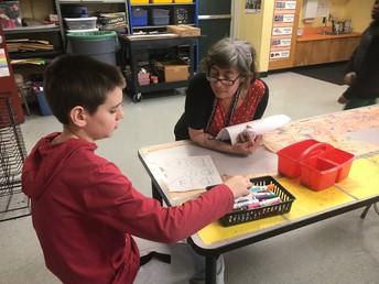 Johanna helps create candy heart messages