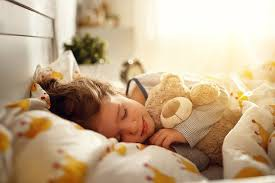 Why is sleep so important for kids and how can I get my child to bed on time?