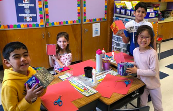 Using geometric shapes to build Valentine's Day boxes!