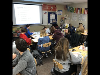 Ms. Dutcher leads learning in a morning Spanish class.