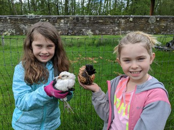 Rylee and Kayla help build a chicken coop!