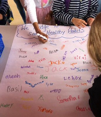 Students sign a Healthy Habits Pledge
