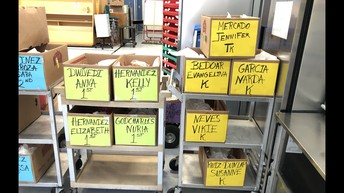 Cafeteria Staff prepare Snack Boxes by Teacher for Recess