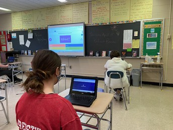 Mrs. Frohm's class uses a Kahoot.it to review concepts from the Giver.