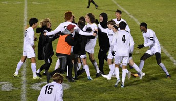 Boys celebrate a victory in the district soccer tournament.