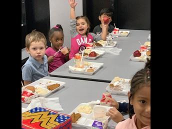 Pre-K really enjoying their lunch!