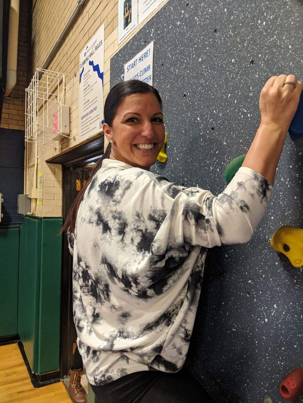 Ms. Esposito showing off her climbing skills on the South Mountain Rock Wall!