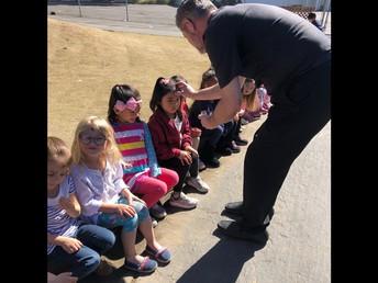 Fr. Ed bringing Ash Wednesday to Preschool!