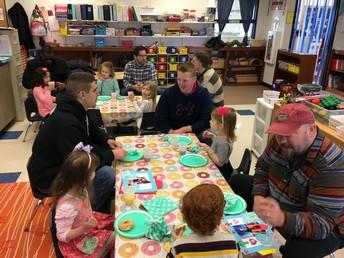 Dads and students enjoying a Saturday morning at school!
