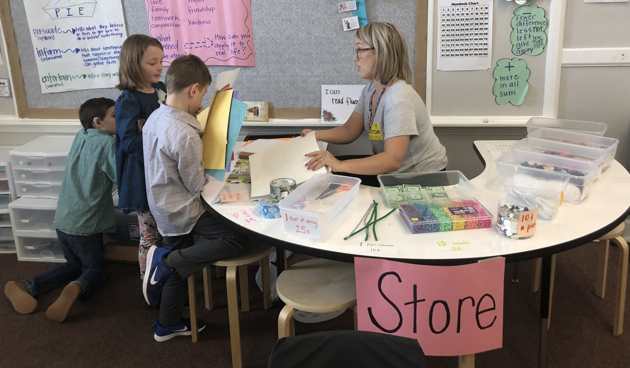 second graders at the classroom store