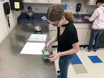 Foods 2 students develop their own popcorn flavoring and prepare it for class