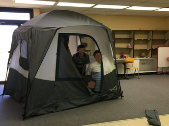 Cooperating To Build A Camping Tent