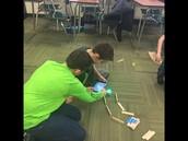 Students working with the University of Oklahoma's One U program