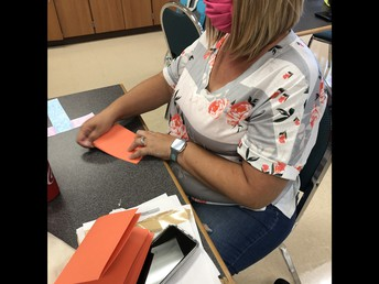 Mrs. Iverson  working on adding a splash of color to CCE!
