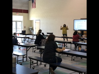 Dr. Gloria Marquez working with teachers to MAP out the Curriculum for 1st 9 Weeks!