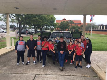 Middle School loading the truck of canned goods for Saint Vincent de Paul.  Thank you to all of our classes for the support