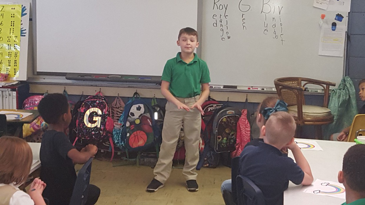 Third-grade student, Woody Bergeron, recently visited Ms. Manuel's 1st-grade class and gave an oral presentation on the Acadians.