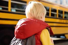Kindergarteners riding the bus