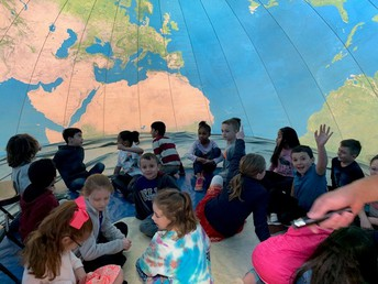 Students inside the Earth Dome