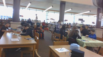 Students (and teachers) busy learning in the library media center