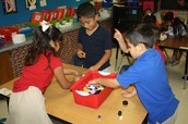 Kindergarteners testing sinking and floating
