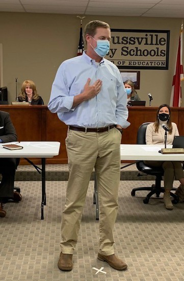 picture of Coach Esslinger addressing the board
