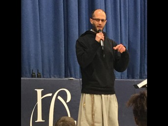 "Father Stephen from the ""Franciscan Friars of Renewal"" speaks to the children at Gathering."