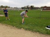 Practicing golf in PE
