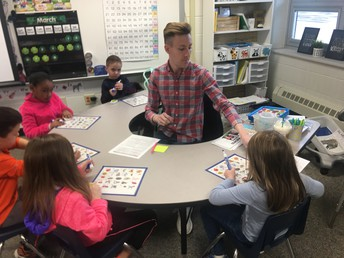 Brandon leads a letter tracing guided reading table.