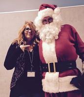 Mrs. Logue cozying up to Santa!