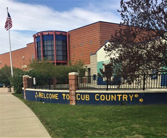 Select students in third grade were chosen to paint the lettering on the wall in front of CSS.