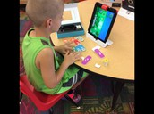 Students in Mrs. Spaugh's 2nd grade class coding with Osmo.