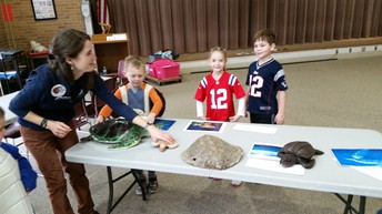 Brady fans learning about turtles with our Audubon Naturalists
