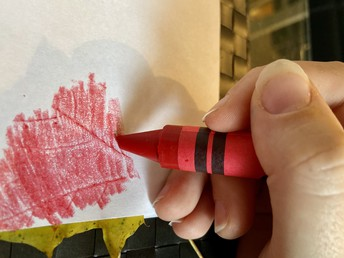 Feel for the leaf under the paper, and then color over that spot with a crayon.
