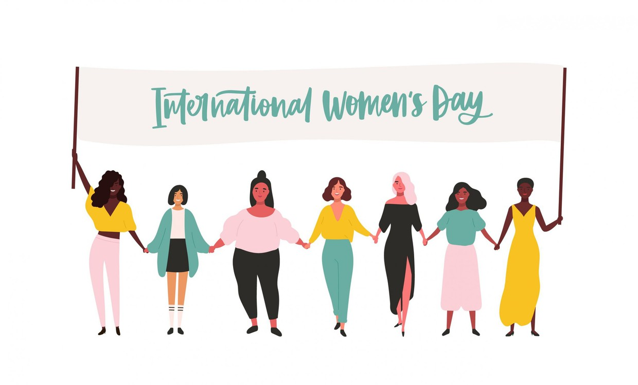 """Seven digital diverse women standing in a line holding a banner stating """"International Womens day"""". Dressed in a color scheme that consists of pastel like blues, pinks, greens, and yellows.  Women of all shapes, sizes, and ages are included in this cute animation."""