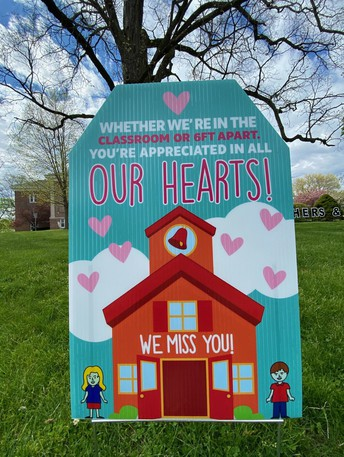 Cos Cob School PTA decorates the school lawn with signage to celebrate their teachers