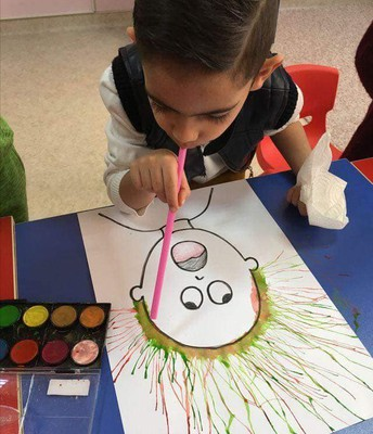 Make crazy hair with paint and a straw