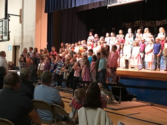"""Second and Third Grade performing at the """"Lights, Camera, Action"""" musical."""
