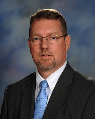 John Childs, Principal