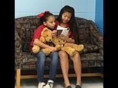 Ava L & Ava H enjoy a good book together!
