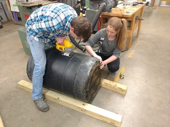 Building a mineral feeder in Agricultural Engineering.